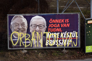 "A billboard from a campaign of the Hungarian government showing European Commission President Jean-Claude Juncker and Hungarian-American financier George Soros with the caption ""You, too, have a right to know what Brussels is preparing to do."" is displayed at a street in Budapest."
