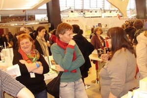 Publisher Virginie Symaniec, left, from French publishing house Le ver à soie, which published book Café Hyena by Jana Beňová, middle, talking with LIC director Miroslava Vallová, right, at the book fair in Paris last year.