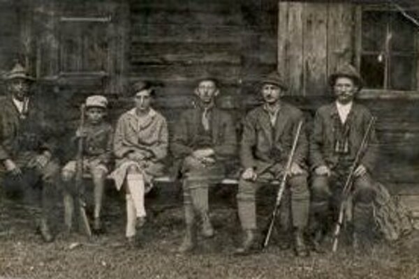 Hunters in front of a lodge