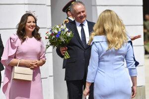 Zuzana Caputova symbolically takes over from Andrej Kiska, accompanied by his wife Martina.