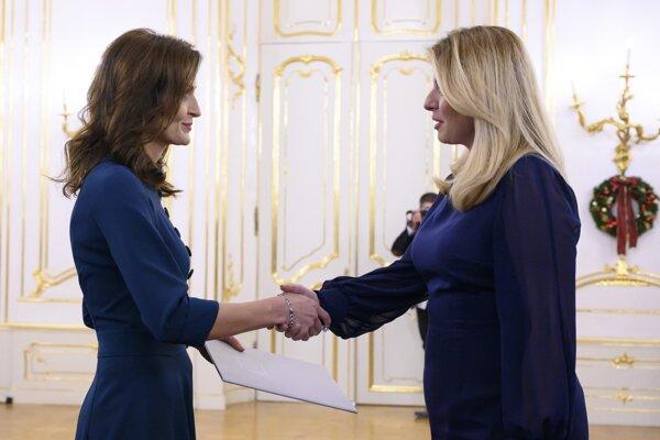 President Zuzana Čaputová thanks Andrea Kalavská for her work as a minister at the Health Ministry in Bratislava on December 16, 2019