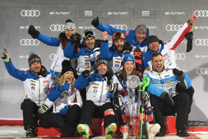 Petra Vlhová celebrates with her team.