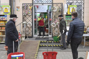 People waiting in front of the garden shop in Košice.