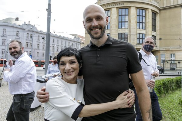 Irena Bihariová and Michal Truban, new and former chairs of Progressive Slovakia, hug each other in Bratislava on June 6, 2020.