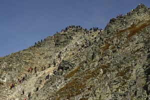 Tourists walk to the top of Rysy (2,503 m) in the High Tatras on September 21, 2020.