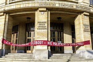 """""""For Academic Freedom - No to Political Arbitrariness"""" reads a writing on facade of Comenius University Law Faculty building."""