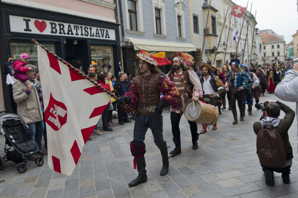 A historical march through Old Town during Bratislava City Days in 2017.