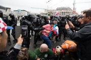 Police had to pacify protesters who tried to block the road near the Presidential Palace.