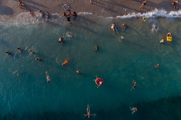 Holidaymakers enjoy the weather on a beach, in Dubrovnik, Croatia, Friday, Aug. 13, 2021.
