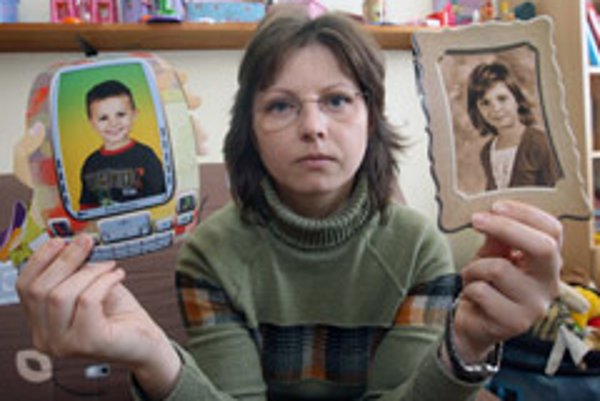 Daniela Hammoud shows pictures of her missing children, Husein and Fatima.