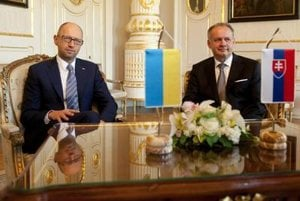 Slovak President Andrej Kiska, right, and Ukrainian Prime Minister Arseniy Yatsenyuk, left, pose before their meeting in Bratislava