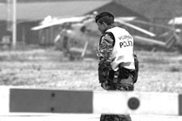 A military policeman looks on in Nováky after the 2007 explosion there.