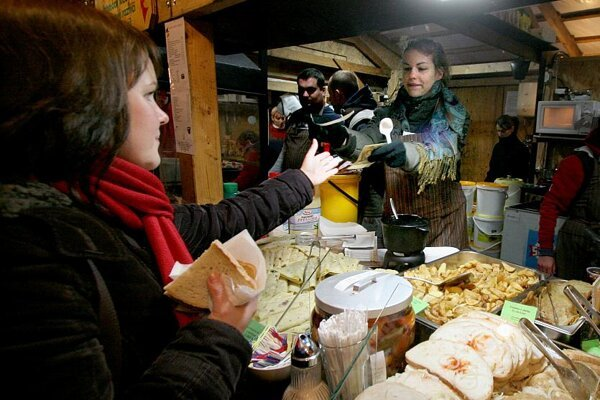 Lokše and bread with lard are among the delicacies available at the Christmas market.