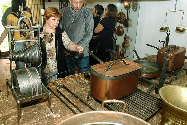 Visitors admire items from Krásna Hôrka Castle.