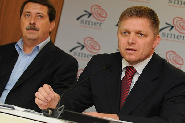Smer leader Robert Fico (right), pictured with party colleague Pavol Paška.