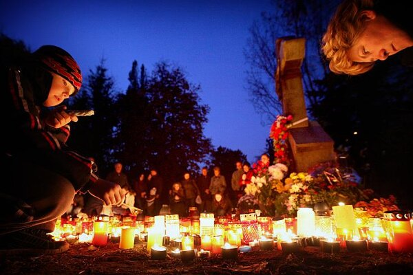 Many candles are lit for deceased relatives on All Saints Day, November 1.