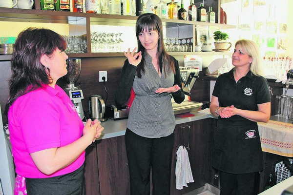 The café's owner (centre) and her staff.