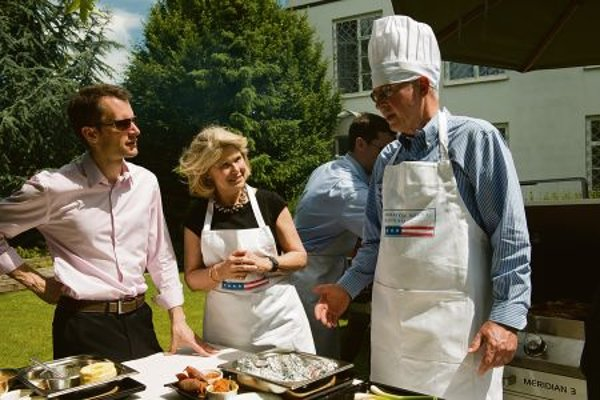 US Ambassador Theodore Sedgwick and his wife Kate Sedgwick prepare the grilled food.
