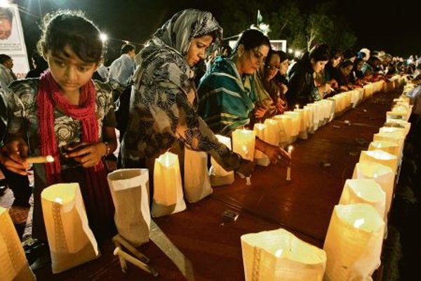 Pakistanis remember the victims of the attack.