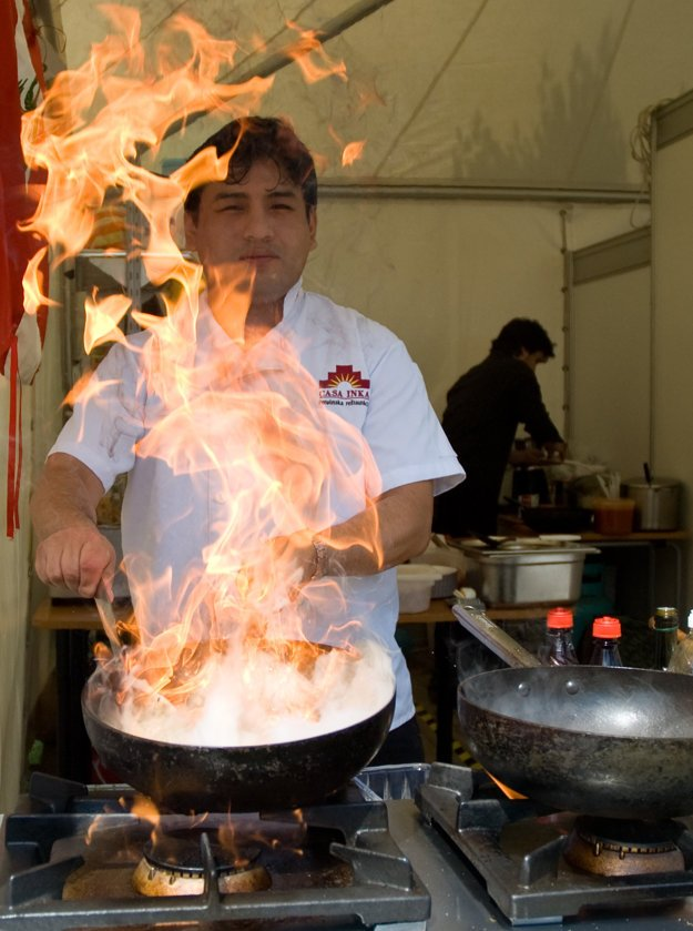 A chef demonstrating his cooking skills.