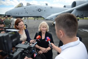 Kathie Baranski Lund answers the questions of journalists at a wreath-laying ceremony for Captain Baranski at Sliač Airfield.