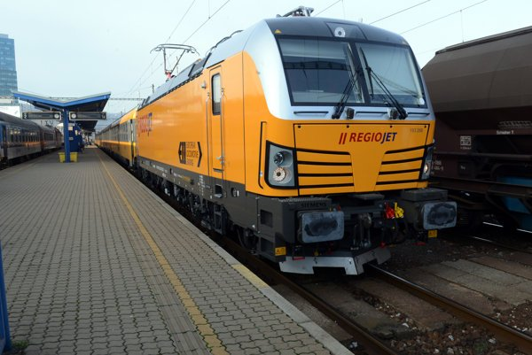 A yellow RegioJet train