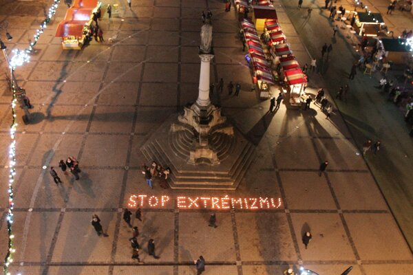 """Activists created the solgan """"stop to extremism"""" with candles during Human Rights Day, on December 10, 2013 in Banská Bystrica."""