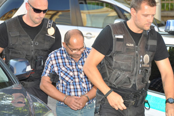 Police escort Igor T.
