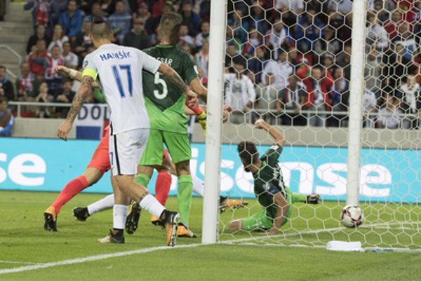 World Cup qualification 2018: Slovakia's Adam Nemec, obscured, scores a goal against Slovenia during their 2018 World Cup Russia group F qualification soccer match between Slovakia and Slovenia in Trnava, Slovakia, September 1.