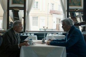L-R: Jiří Menzel and Peter Simonischek in The Interpreter.