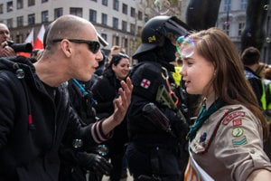 The photograph of Girl Scout Lucie Myslíková, aged 16, confronting an extremist was taken in the Czech city of Brno, during the May 1 protest called Those Who Play Do Not Salute the Nazi Way. The participants tried to block a neo-Nazi march, in a light-hearted way.