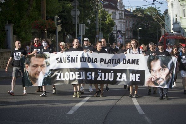 One of the protests against the practices of Bašternák (L on the banner) and his connections with the Smer Interior Minister Robert Kaliňák (R).