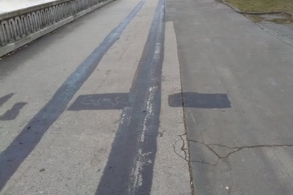 Lines of cycling path painted out in black.
