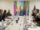 US Secretary of Defense Ash Carter (L), speaks with NATO Secretary General Jens Stoltenberg (2R) during a meeting at NATO headquarters in Brussels on February 10