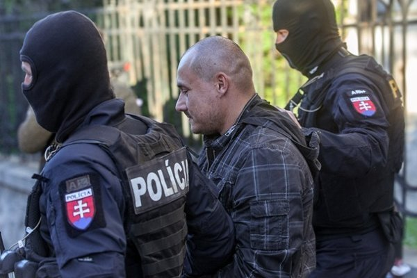 Alleged hitman Tomáš Sz. is led to court hearing.
