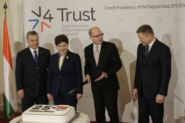 Prime Ministers of Hungary Viktor Orban, Poland Beata Szydlo, Czech Republic Bohuslav Sobotka and Slovakia Robert Fico, from left, are about to cut a cake to celebrate the 25th anniversary of the establishment of the Visegrad group prior to a Summit of the V4 Prime Ministers with the Prime Minister of Bulgaria and the President of Macedonia in Prague on February 15.