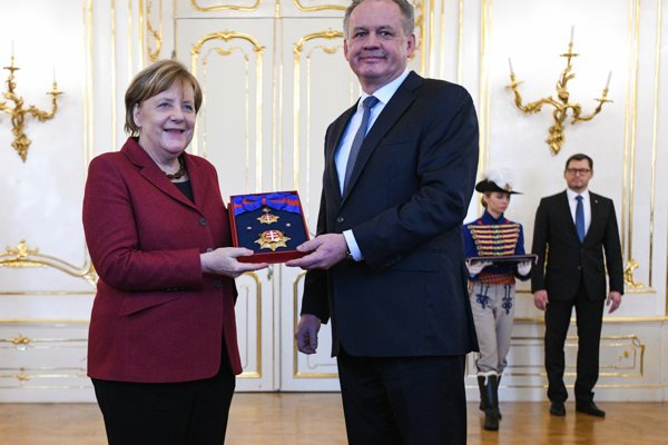 President Andrej Kiska presented German Chancellor Angela Merkel with the Order of the White Double Cross.