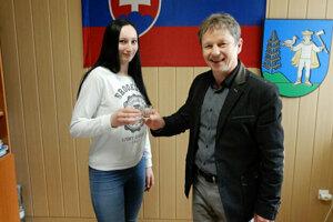 Liptovské Kľačany mayor Ján Hollý raising a glass with one of the first-time voters.