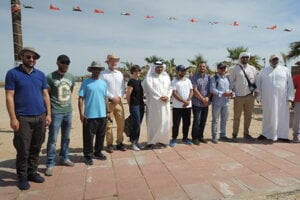Sultan Al-Duweish, director of Kuwaiti national museum with workers of museum.