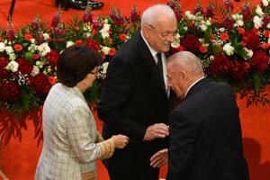 Former President Ivan Gašparovič with wife Silvia greet former President Rudolf Schuster at the inauguration of Zuzana Čaputová.