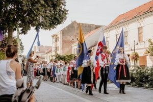 A traditional march of folk dancers wearing traditional costumes during the Trnava Gate folk festival in August 2018.