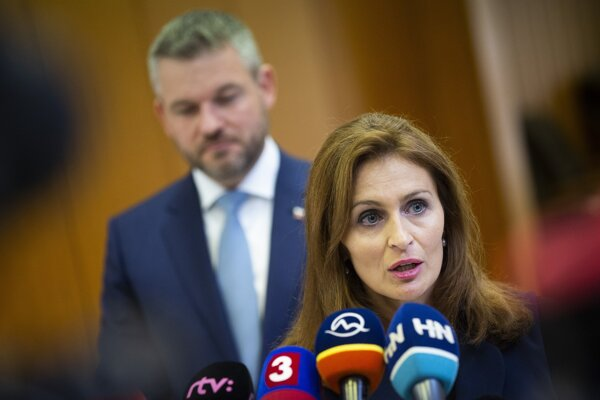 Health Minister Andrea Kalavská talks to the media after the government's meeting on September 27, 2019. PM Peter Pellegrini stands in the background