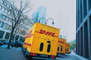 DHL transport vehicles, illustrative stock photo