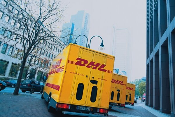 DHL transport vehicles, illustrative stock photo