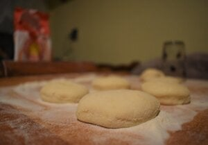 Circles cut out from dough.