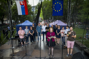 Beata Balogová speaks to one of the For a Decent Slovakia protests in 2018 on behalf of Slovakia's journalists. Balogová also serves as the vice-chair of the executive board of the International Press Institute.
