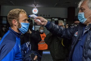 Football club Slovan Bratislava has resumed training sessions at the football pitch. Pictured above, each player gets their temperature measured on May 12, 2020.