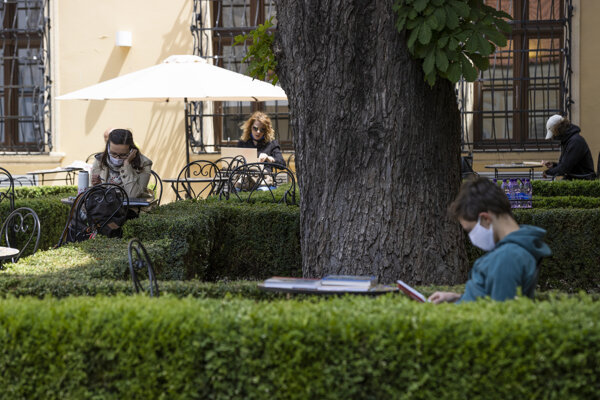 People read in the Liszt Garden of the University Library in Bratislava, which serves as a reading and study space on the first day of its reopening on May 27, 2020. The University Library in Bratislava also reopened its gates to the public on Wednesday.