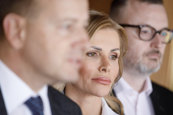 Petra Krištúfková with Sme Rodina leader Boris Kollár in the front and Labour Minister Milan Krajniak in the background.
