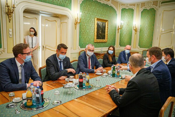 PM Igor Matovič, second from right, meeting with VW Slovakia representatives - Oliver Grünberg, the Chairman of the Board of Volkswagen Slovakia, and Andreas Tostmann, second and third from left.